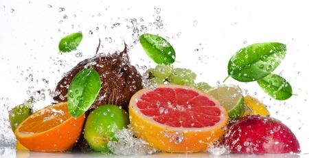 Fresh fruits with water splash isolated on white photo