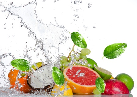 fruit drop: Fresh fruits with water splash isolated on white