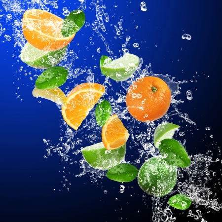 Tropical fruits in water splash photo