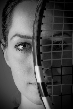 Portrait of girl with tennis racket photo