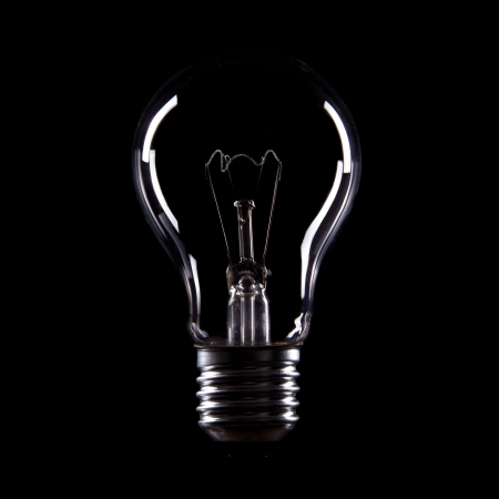 Light bulb on black background Standard-Bild