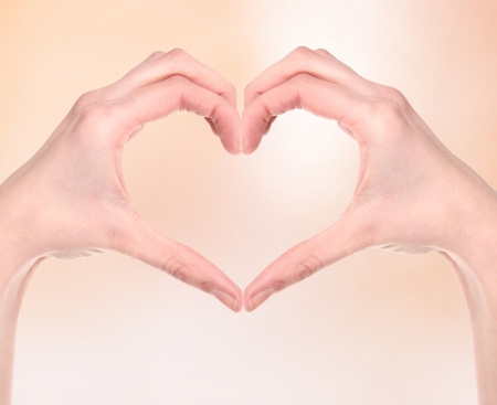 Woman hand making sign Heart Stock Photo - 18964784