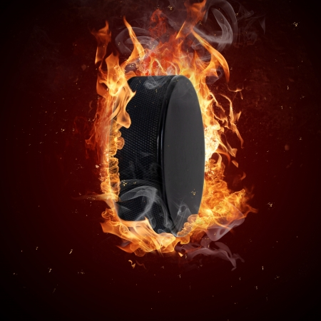 Hot hockey puck in fires flame photo