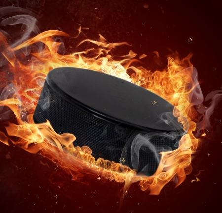ice hockey puck: Hot hockey puck in fires flame