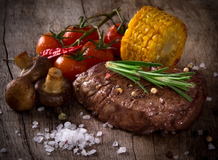 steak dinner: Delicious beef steak on wooden table