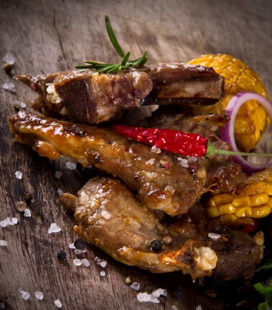 medium close up: Delicious lamb chops on wooden table