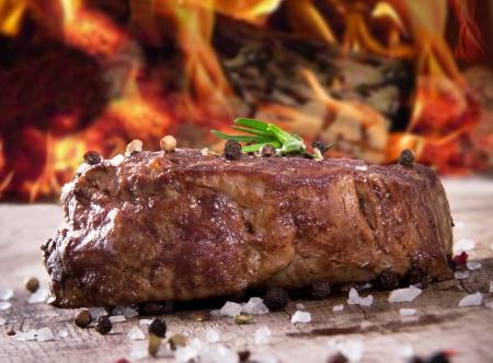 steak: Delicious beef steak on wooden table