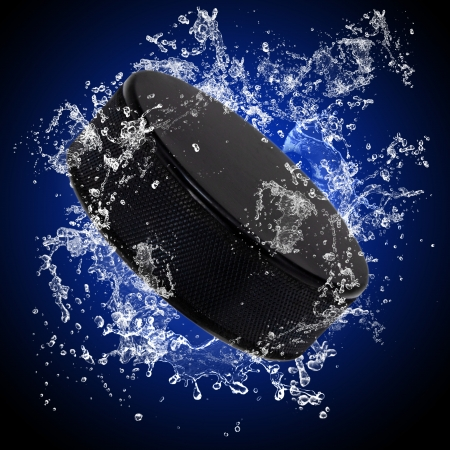 Hockey puck in splashing water photo