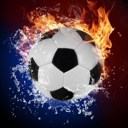 extreme heat: Soccer ball in fire flames and splashing water