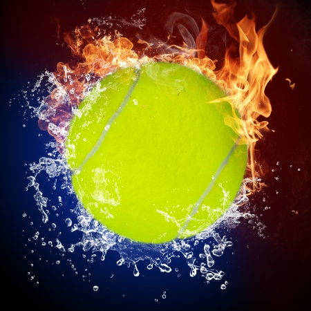 extreme heat: Tennis ball in fire flames and splashing water Stock Photo
