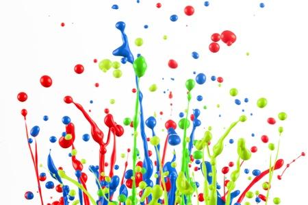 Colorful paint splashing isolated on white Stock Photo