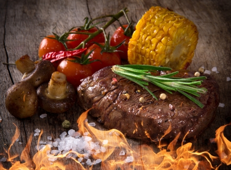charbroiled: Delicious beef steak on wooden table
