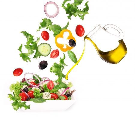 greek chef: Salad with flying ingredients Stock Photo