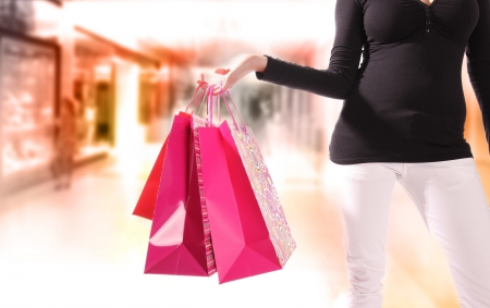 Woman with shopping bags in shopping center photo