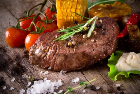 grilled steak: Delicious beef steak on wooden table