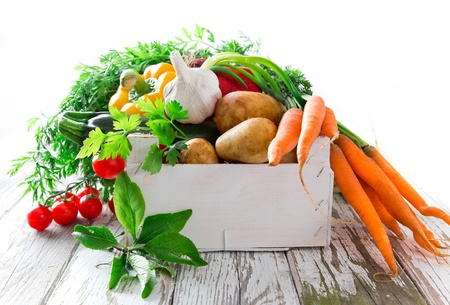 Fresh vegetable on wooden background photo