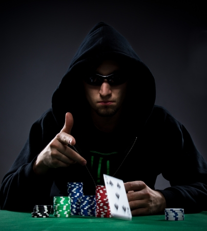 games hand: Portrait of a professional poker player Stock Photo