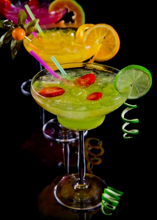 Fruit cocktails on black background photo