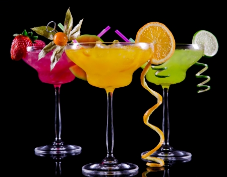Fruit cocktails on black background Stock Photo - 20043637