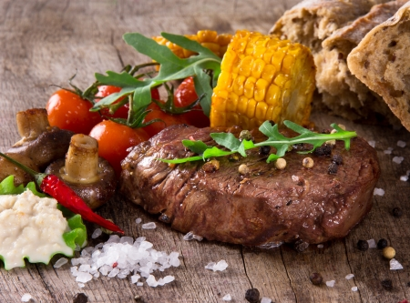 medium close up: Delicious beef steak on wooden table