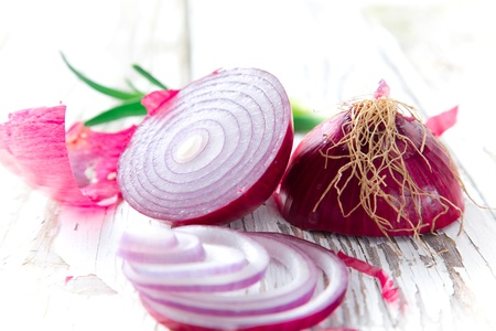 Purple onion on wooden background photo