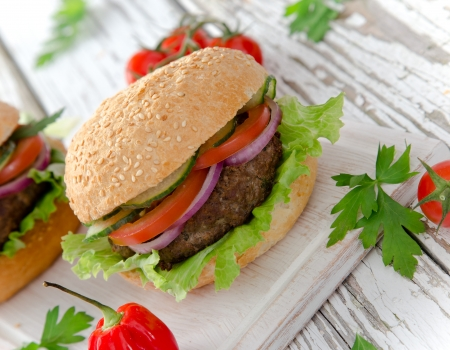 Delicious hamburgers on wooden background Stock Photo - 20099255