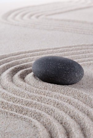 zen stone in the sand photo