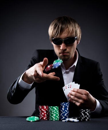 croupier: Portrait of a professional poker player Stock Photo