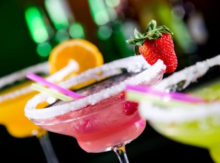 martini splash: Fruit cocktails on black background