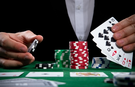 casino table: Portrait of a professional poker player Stock Photo