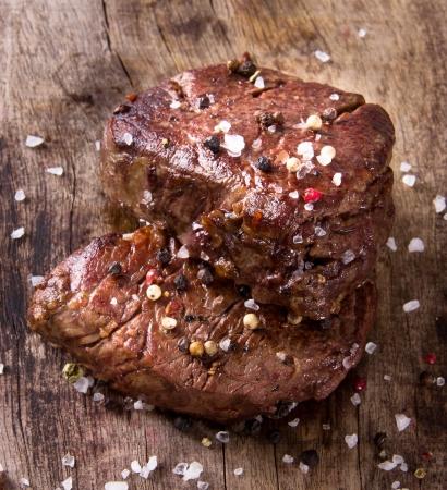 steak dinner: Delicious beef steak on wooden table