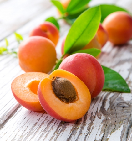 apricot: Fresh apricots on wooden table