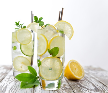 Lemons with fresh cold mineral water in a glass photo