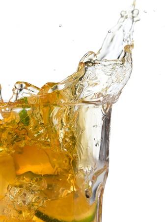 ice lemon tea: Glass of ice tea with ice-cubes on white background