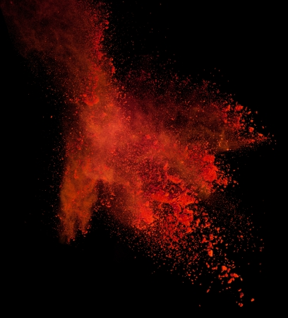 black out: Launched colorful powder, isolated on black background