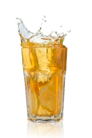 ice tea: Glass of ice tea with ice-cubes on white background