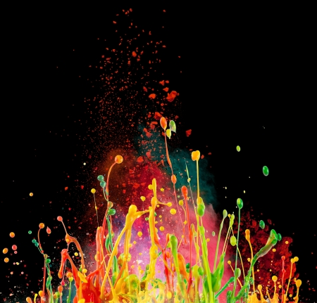 paint drips: Colorful paint splashing isolated on black
