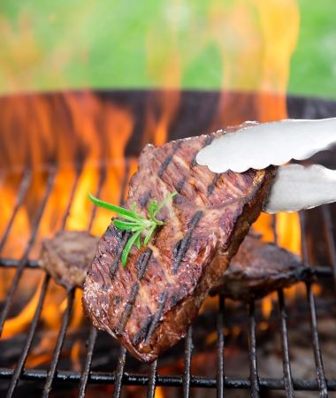 closeup of steak on a grill photo