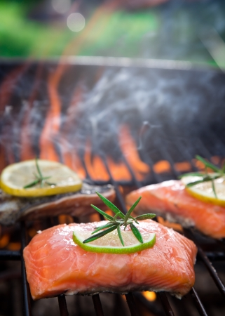 Salmon fillets on the grill with flames photo