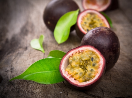 exotic fruit: Passion fruits on wooden background Stock Photo