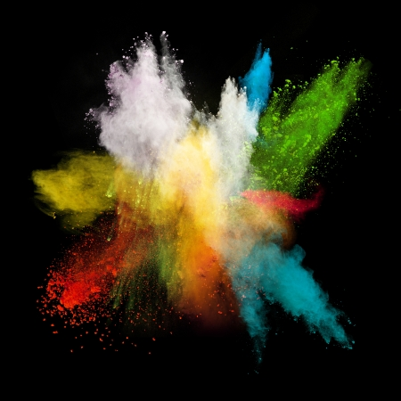 colorful background: Launched colorful powder, isolated on black background