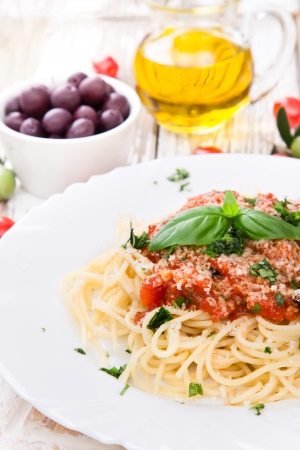 Spaghetti with tomatoes on wooden table Stock Photo - 21157798