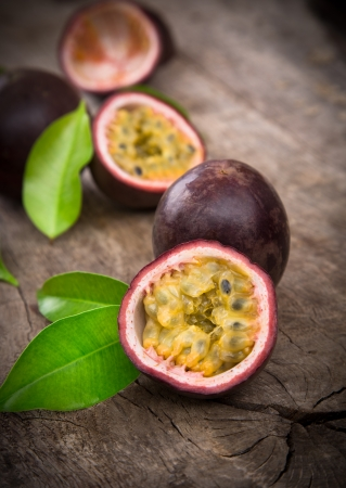 Passion fruits on wooden background Stock Photo