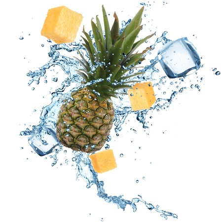 Pineapple with water splash over white background photo