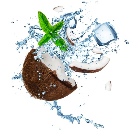 Coconut with splashing water over white photo