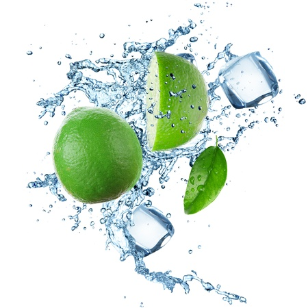 Limes and Splashing water over white Stock Photo - 21157672