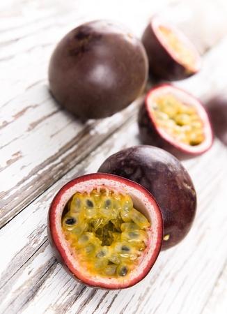edulis: Passion fruits on wooden background Stock Photo