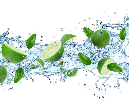 Limes and Splashing water over white photo