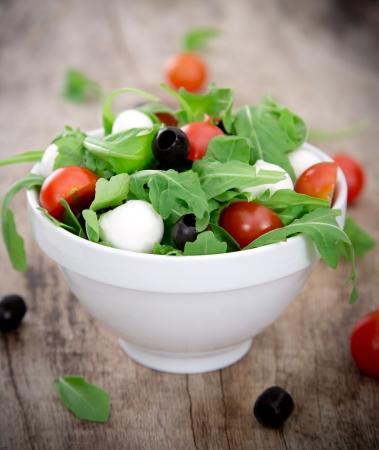 greek chef: Fresh salad over white background