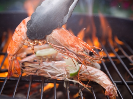 Grilled prawns on flaming grill
